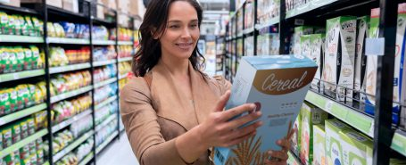 woman looking at cereal package